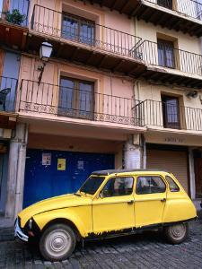 Yellow Citroen Parked Outside Apartments, Calatayud, Spain by John Banagan