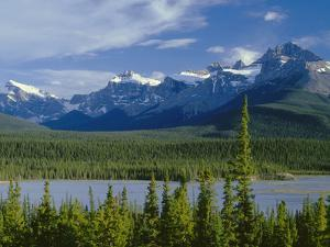 Alberta, Banff National Park, Mount Sarbach and Kaufmann Peaks Rise Above North Saskatchewan River by John Barger