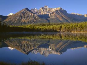 Canada, Alberta, Banff National Park, Early Morning Light on the Bow Range Reflects in Herbert Lake by John Barger