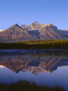 Canada, Alberta, Banff National Park, Sunrise Light on the Bow Range Reflects in Herbert Lake by John Barger