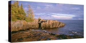 Minnesota, Lichen Covered Rocks and Stormy Sky over Lake Superior at Artist Point by John Barger