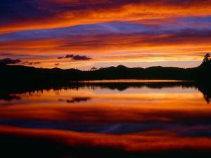 USA, Colorado, Sunset Ignites the Sky over Echo Lake, Arapaho National Forest by John Barger