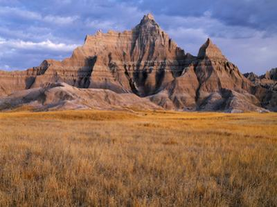 USA, South Dakota, Badlands National Park, Storm clouds over Vampire Peak by John Barger
