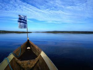 Bow of Boat with Flag Rovaniemi, Lapland, Finland by John Borthwick