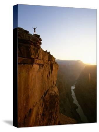 A Hiker Surveys the Grand Canyon from Atop Toroweap Overlook by John Burcham