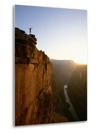 A Hiker Surveys the Grand Canyon from Atop Toroweap Overlook