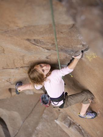 A Young Girl Rock Climbing by John Burcham