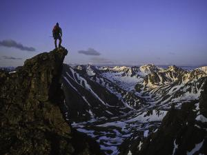 One Man Standing on a Summit in Denali National Park, Alaska, Denali National Park, Alaska by John Burcham