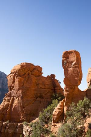 Rock Climber on a Sandstone Spire in Sedona, Arizona by John Burcham