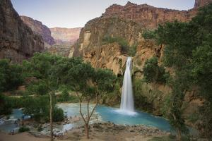 The turquoise waters of Havasu Falls at sunset in Havasupai. by John Burcham