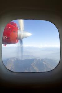 View of the Himalayan Mountains and Moving Airplane Propeller Seen Through Window by John Burcham