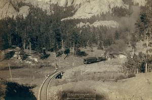 """""""Horse Shoe Curve."""" on Burlington and Missouri River Railway. Buckhorn Mountains in Background by John C.H. Grabill"""