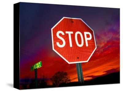 Stop Sign with an Intense Red Sunset in the Backround