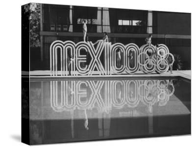 6 Foot Sign Will Stand Outside Each Arena and Stadium of 1968 Olympics, to Be Held in Mexico City