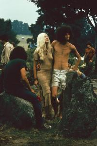 A Couple Stand Together at the Woodstock Music and Arts Fair, Bethel, New York, August 1969 by John Dominis
