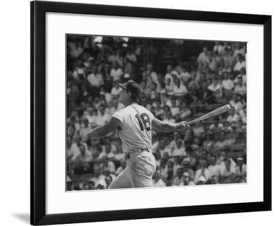Action Shot of Cincinatti Red's Ted Kluszewski, Following the Direction of Baseball from His Hit