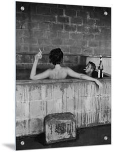 Actor Steve McQueen and Wife Taking Sulfur Bath at Home by John Dominis