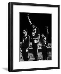 African American Track Star Tommie Smith, John Carlos After Winning Gold and Bronze Olympic Medal by John Dominis