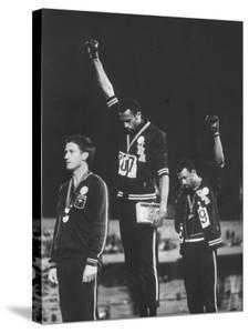 African-American Track Stars Tommie Smith and John Carlos after Winning Olympic Medals by John Dominis