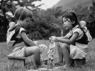 American Child Playing with Chinese Friend, Washing Doll Clothes