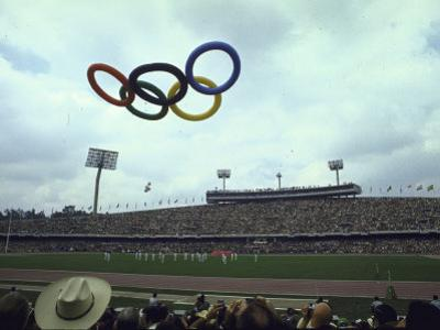 Balloons in the Shape of the Olympic Rings Being Released at the Summer Olympics Opening Ceremonies by John Dominis