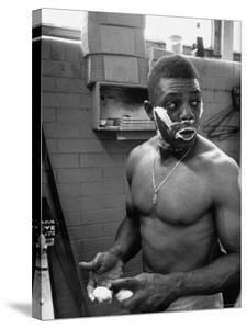 Baseball Player Willie Mays Shaving in the Locker Room by John Dominis