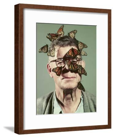 Butterfly Breeder Carl Anderson with Monarch Butterflies on His Face