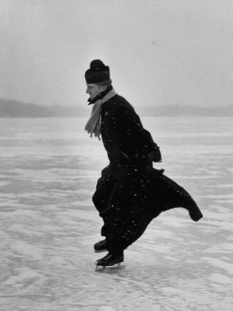Catholic Priest Ice Skating. from Photo Essay Re Polish American Community by John Dominis