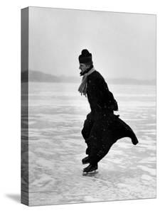 Catholic Priest Ice Skating by John Dominis