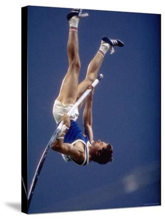 East Germany's Wolfgang Nordwig in Action During Pole Vaulting Event at the Summer Olympics
