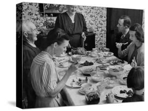 Family Eating at Dinner Table by John Dominis