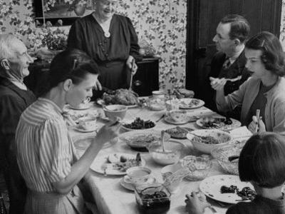 Family Eating at Dinner Table