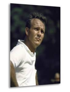 Golf Pro Arnold Palmer Squinting Against Sunlight During Match by John Dominis