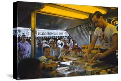 In a Booth at the Iowa State Fair, a Man Demonstrates 'Feemsters Famous Vegetable Slicer', 1955