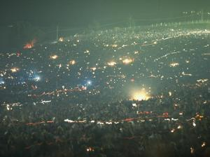 Long Exposure of Huge Night Time Crowd, Showing Lights All Over, Woodstock Music and Art Fair by John Dominis