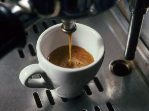 Machine Pouring Cup of Espresso by John Dominis