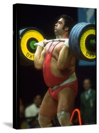Male Lifting Heavy Weights in Competition at the Olympics
