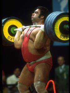 Male Lifting Heavy Weights in Competition at the Olympics by John Dominis