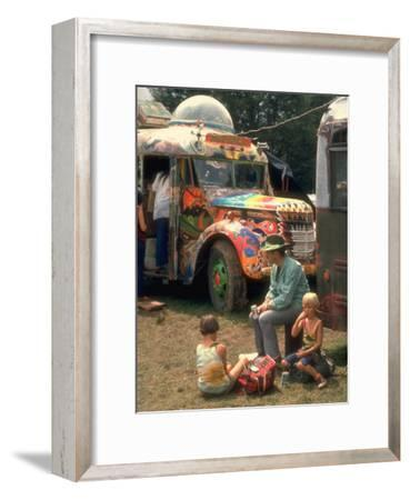 Man Seated with Two Young Boys in Front of a Wildly Painted School Bus, Woodstock Music Art Fest