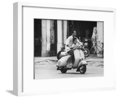 Man with His Son on Scooter