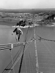 Man Working on the Texas Illinois Natural Gas Company's Pipeline Suspension Bridge by John Dominis
