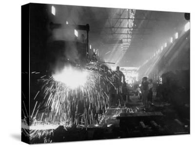 Men Working in an Iron Works Plant