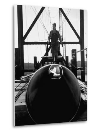 Men Working on the Texas Illinois Natural Gas Company's Pipeline Suspension Bridge