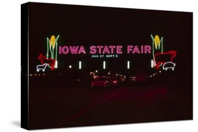 Nighttime View of the Illuminate Neon Sign at the Entrance to the Iowa State Fair, 1955