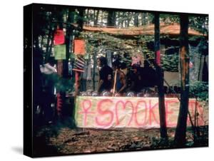 Paraphernalia Stand in Woods Featuring Pillows, Posters, and Incense, Woodstock Music and Art Fair by John Dominis