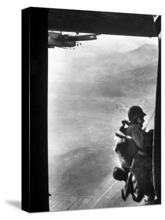 Paratrooper Making Way to Jump Off a Military Plane into Hostile Territories