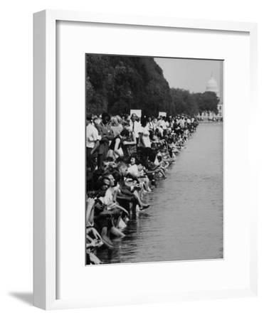 People at Civil Rights Rally Soaking their Feet in the Reflecting Pool at the Washington Monument