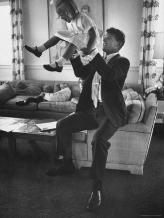 Robert F. Kennedy Playfully Tossing His Daughter Mary Kerry Kennedy Into the Air