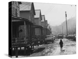 Small Girl Walking Down the Poverty Stricken Town of Hemphill in Appalachia by John Dominis