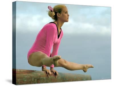 Teen Gymnast Cathy Rigby Performing on Balance Beam